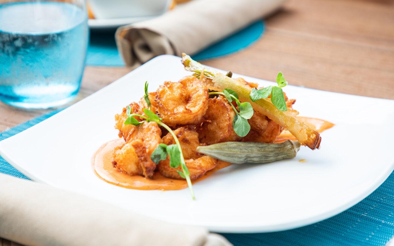 Shrimp entree dish on white plate at BLU Folly Beach