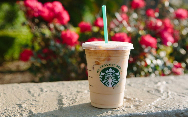 plastic Starbucks cup holding iced coffee