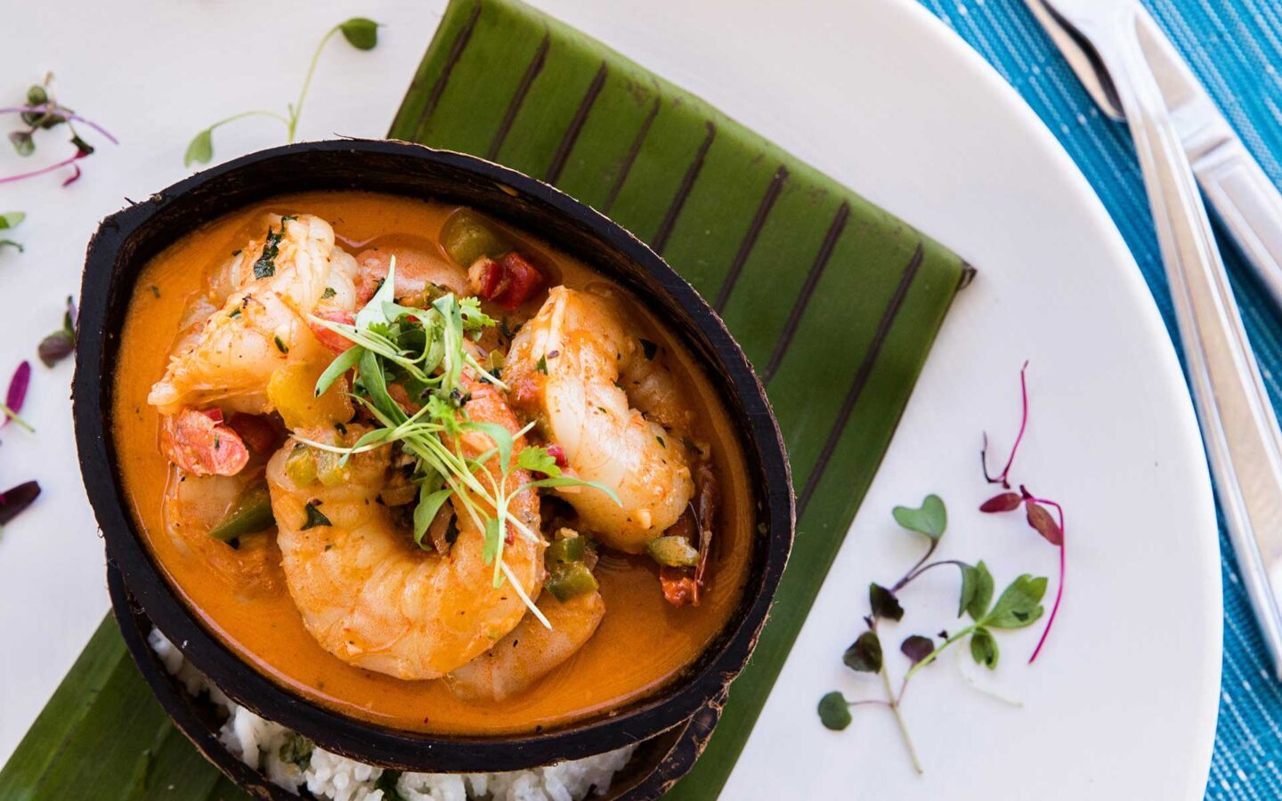 shrimp curry dish on top of leaf plate