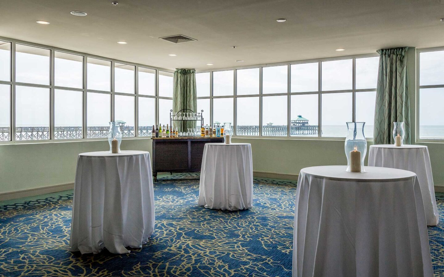 four cocktail tables within event venue