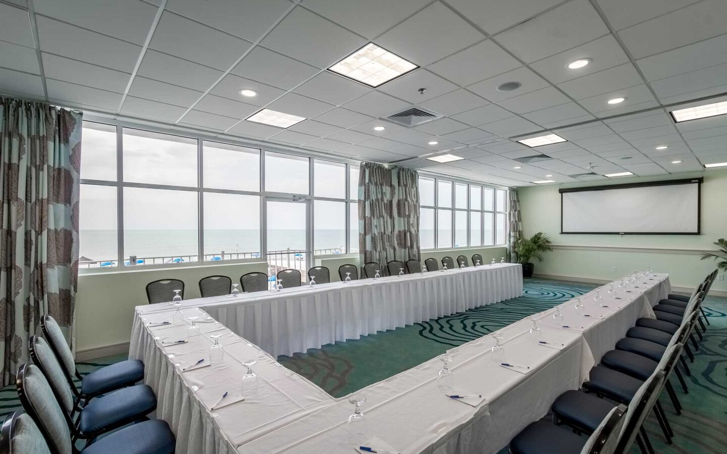 boardroom meeting venue with beachfront views from window