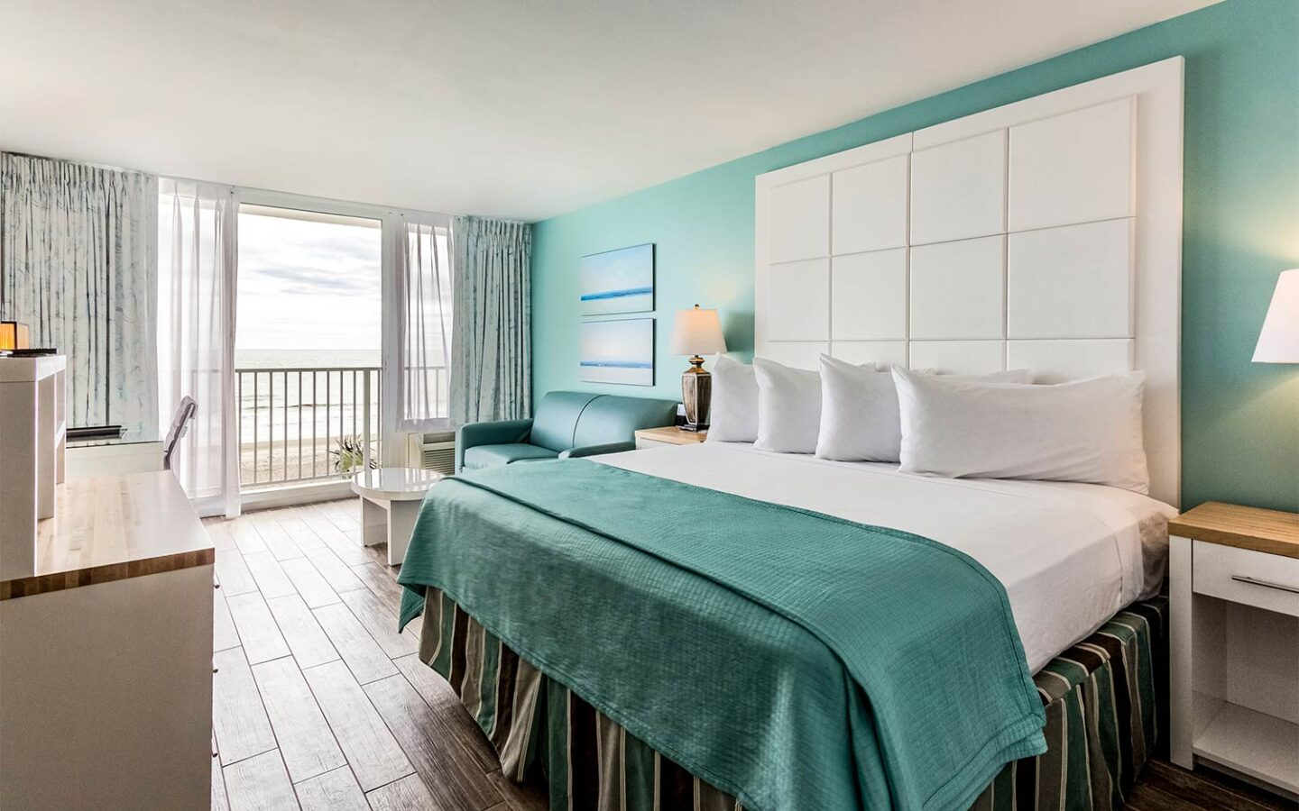 large king bed with views of beachfront pier