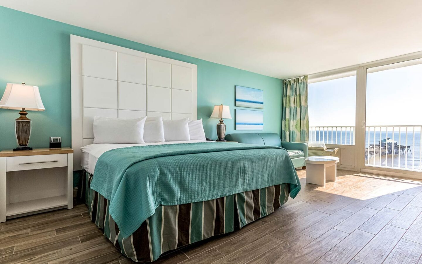 large king bed with views of beach front pier