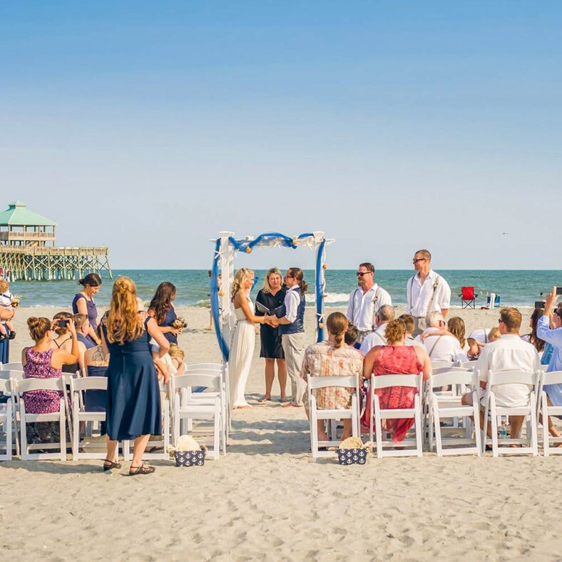 folly beach wedding venue and ceremony with guests overlooking pier