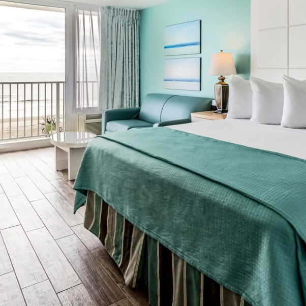 oceanfront accessible hotel room with close up of large king bed and couch area